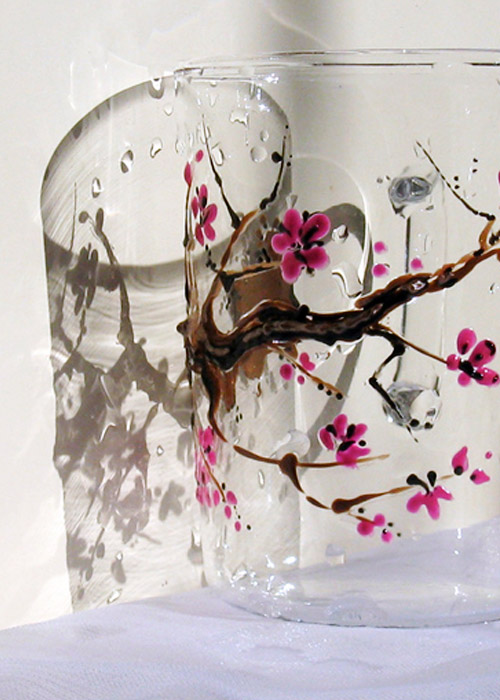 glass with blossoming branch
