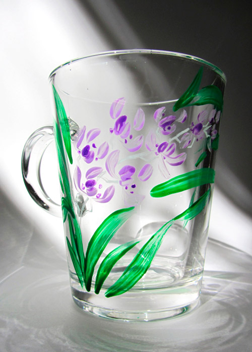 glass with orchid