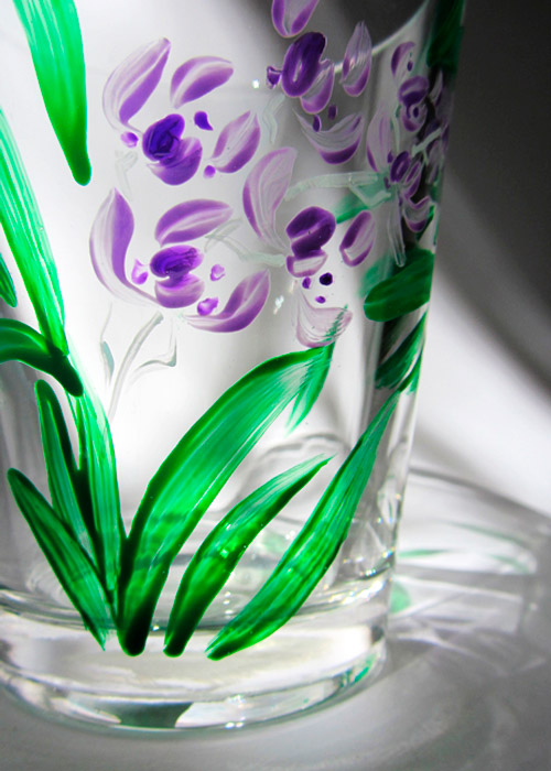 glass with orchid - part