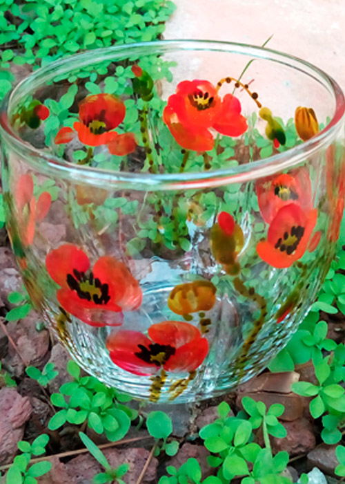 glass with poppies
